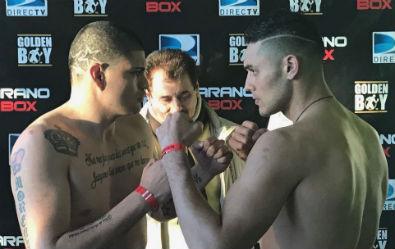 Cisneros (izquierda) y Peralta (derecha) mirándose desafiantes luego del pesaje.